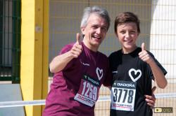 Padre e figlio con maglie di squadre diverse ma in corsa insieme alla Run Together